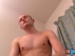 Cute twink shows off his feet and toys his big dick