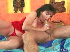 Busty fat grandma enjoys hard sex