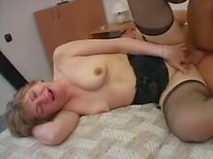 Mature old whore rages behind a young dick.