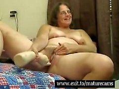 Granny Jenny masturbates with large objects