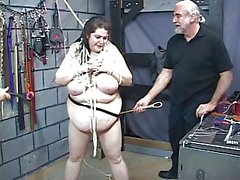 Thick bbw slave girl is restrained by two bdsm dungeon master guys