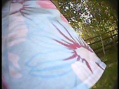 Hottie in a flowered skirt gives a good cheek shot on hidde