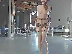 Masked beauty with nude vagina receives spanking