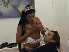 Brunette whore nurse gives her patient a special treatment