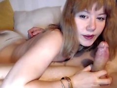 Kinky short haired redhead gives big cock a blowjob