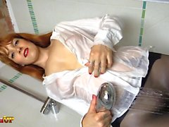 Redhead takes a shower in black pantyhose