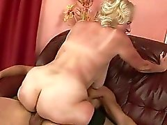 Granny enjoying sex with young man