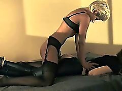 Brunette model gets fucked with strap on