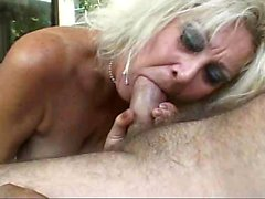 Granny sucking and slurping on hard cock