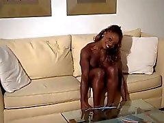 EBONY MUSCLED BODYBUILDER GIRL IN THONG FBB(WheelSex)