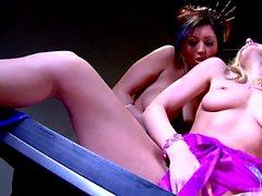 Leggy blonde rubs her clit while brunette licks her