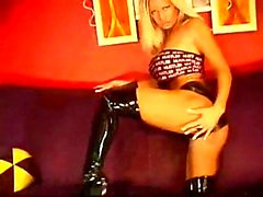 Huge boobs blonde in latex boots