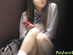 Asian student rubs pussy