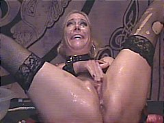 Blonde on a platform masturbating and drinking slimy mess