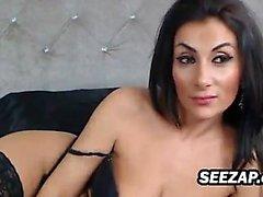 Brunette in white lingerie masturbates