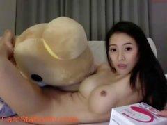 horny asian camgirl fuck a teddy bear on cam
