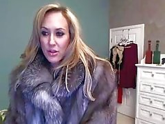 Ms. Brandi has cam fun in her fur coat, and with a toy