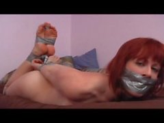 red head duct tape hogtied and gagged