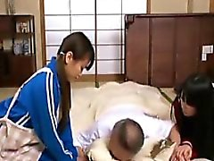Two Asian cuties help make him feel better by giving him pu