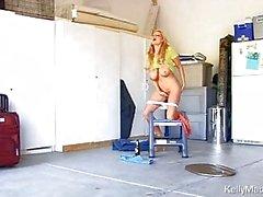 Blonde milf teasing with bottle of bear between huge knockers