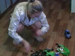 Girl crushing toy cars barefoot