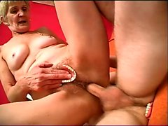 Blonde granny uses her dentures to pleasure herself while getting nailed