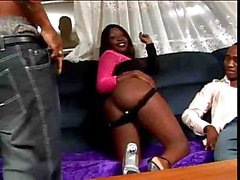 Black babe is sucking and fucking these two studs hard black cocks