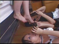 Two young brunette maids must cater to their mistress and lick her feet