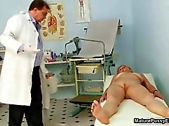Granny gets a full body inspection from her doctor