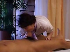 Sensuous Japanese masseuse works her lips on every hard inc