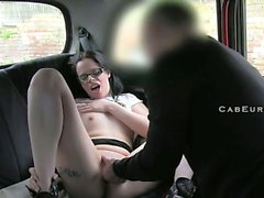 Amateur with glasses gets facial in taxi