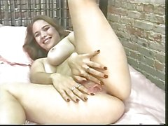 Chick strips and inserts fingers in her pink cunt