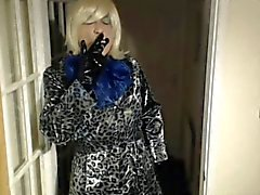 Candi Smokes in her pvc shiny coat