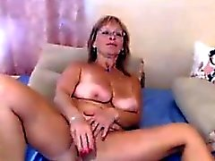 Mom Wearing Glasses Masturbates With A Dildo