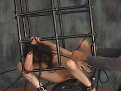 BDSM brunette tramp bound to cage and rides vibrator and dildo