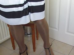 Pleated skirt and nylon slip wank