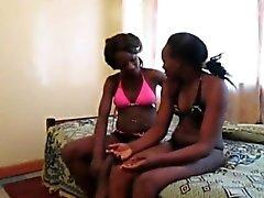 African lesbians Urbi and Iverem enjoy dildo fucking