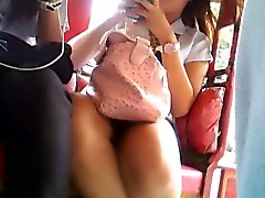Lovely Asian chick wears a skirt and exposes her lovely leg