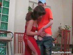 Brunette gives boy her warm