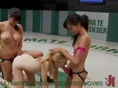 Three naked chicks wrestling and getting fucked by a strapon