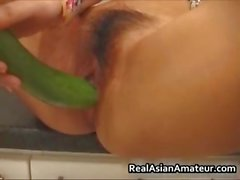 Asian girlfriend stuffs her pussy
