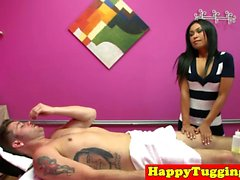 Gorgeous asian masseuse tugs clients cock