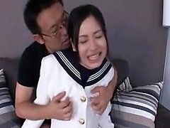 Pretty Japanese schoolgirl has a kinky guy caressing her lo