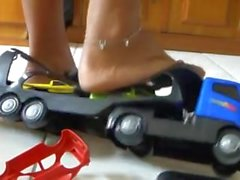 Brazilian giantess Paula crushes a car truck bare foot