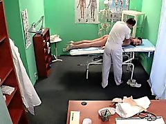 Fake doctor pussylicks nurse on exam table