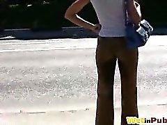 Shy amateur chick pissing through pants
