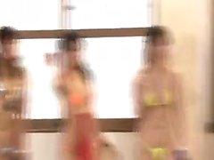 Sensual Asian babes in tight bikinis put their hot curves o