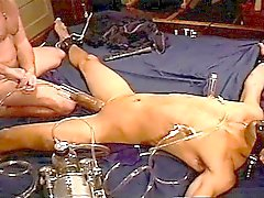 Extreme vacuum pumping on bound and restrained muscle guy.