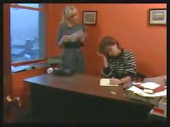 Classic office porn with blonde taking on two cocks at work