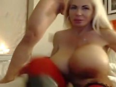 Huge Fake Tits Granny gives epic Blowjob